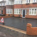 Charcoal/bracken paving